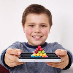 Child holding SmartGames IQ Puzzler Pro