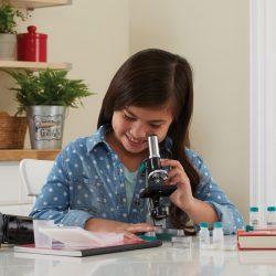 Child using the Geovision Elite 98 Piece Microscope Set