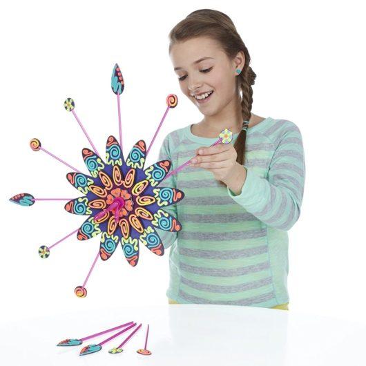 Girl assembling the Dohvinci clock kit